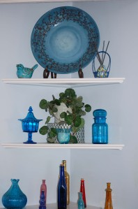 decorations on faux cabinet shelves