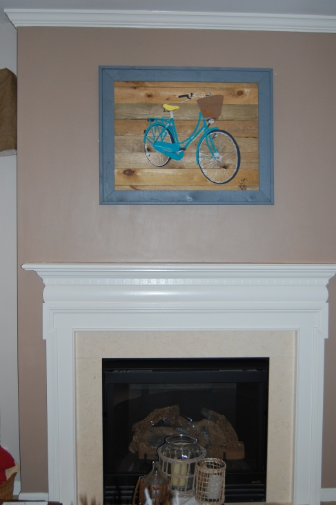 Bike art hung over mantel
