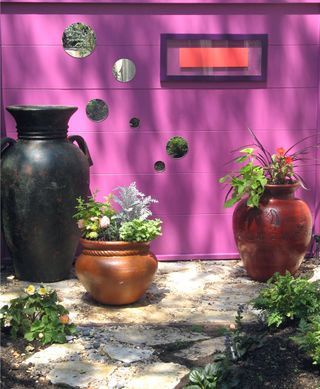 Fuchsia wall on patio
